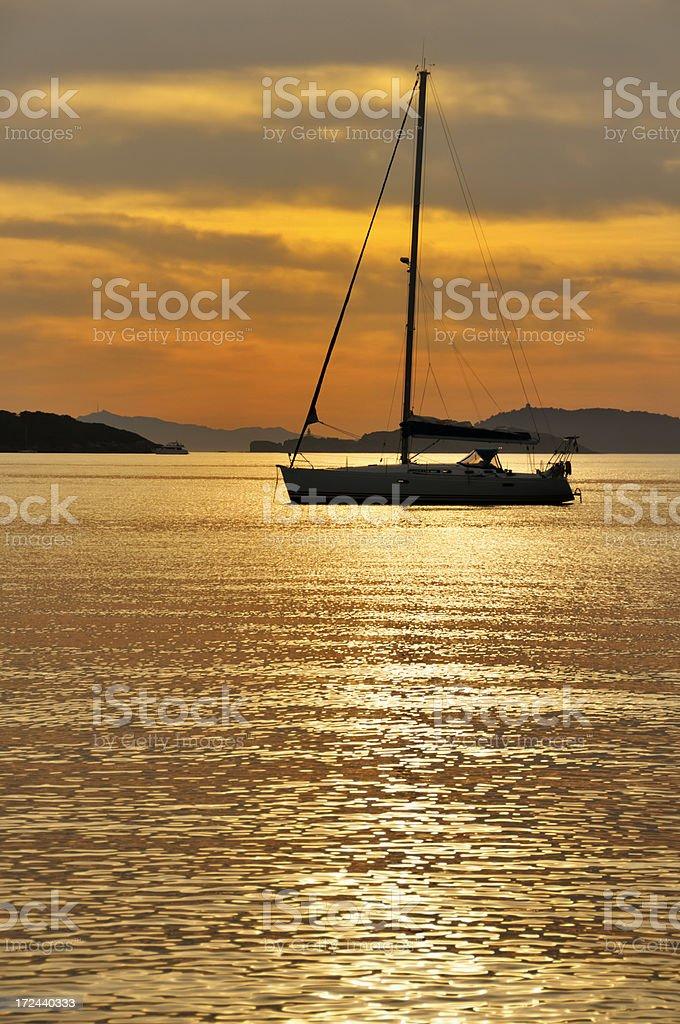 Sailboat at sunset royalty-free stock photo