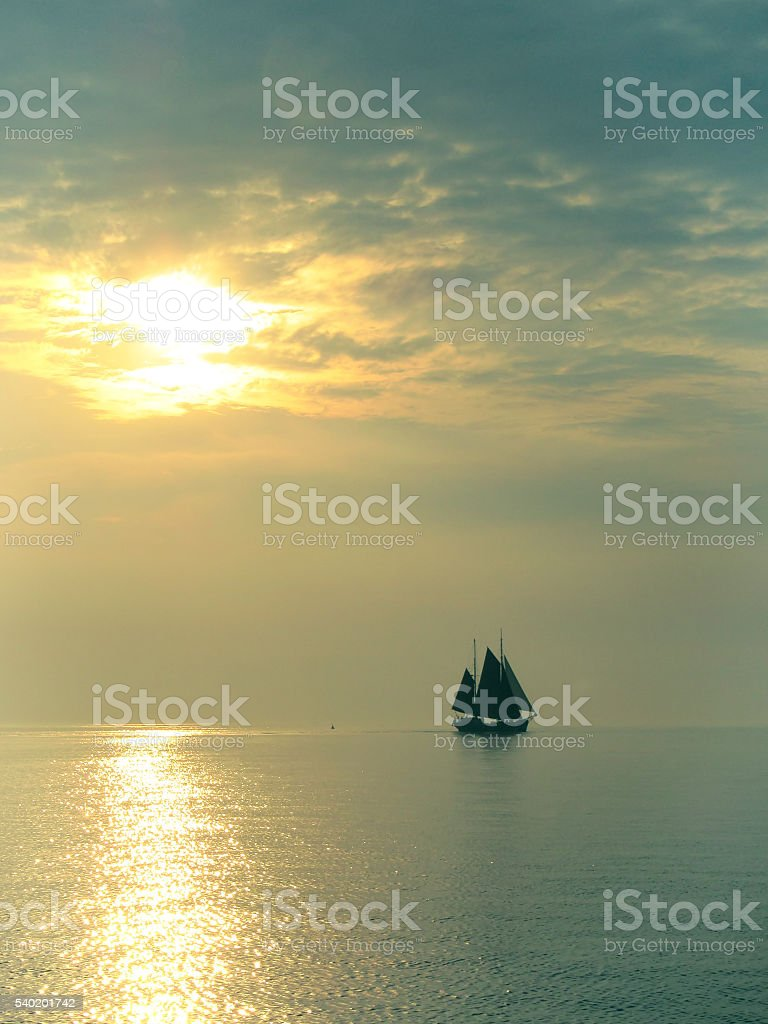 Sailboat at the evening stock photo