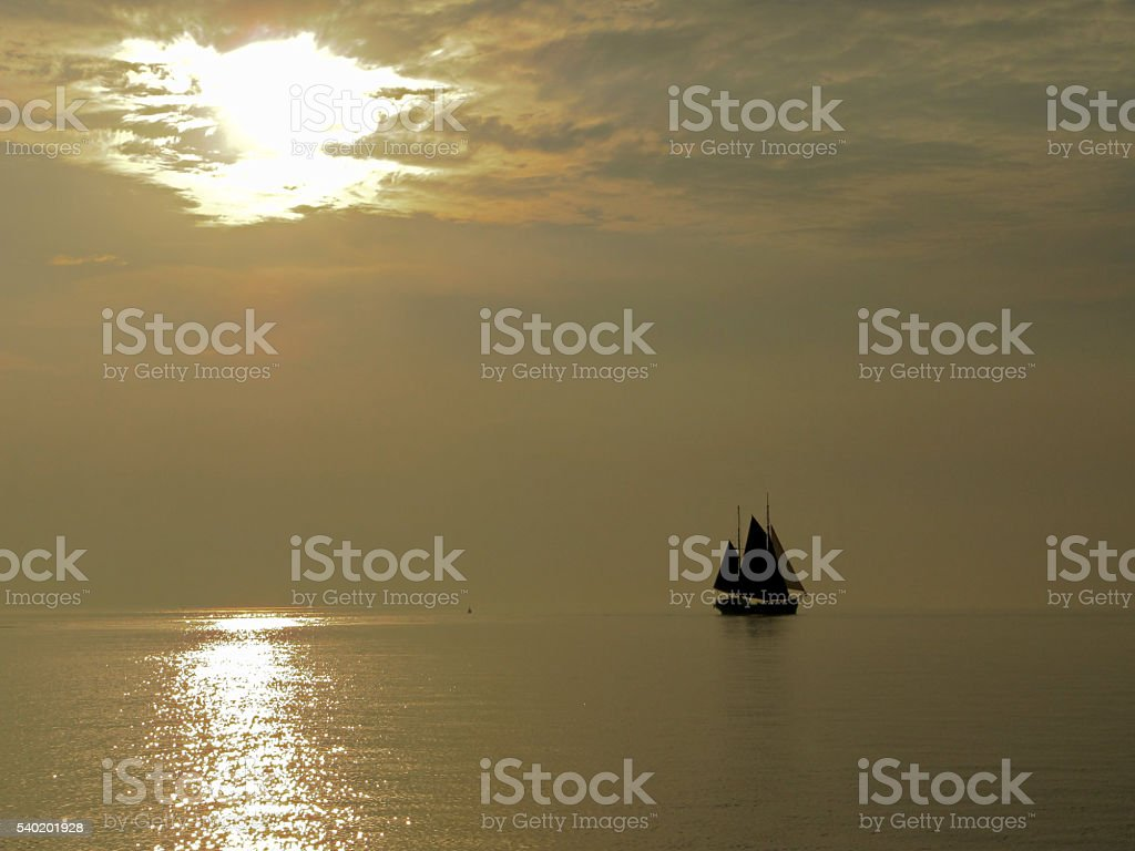 Sailboat at the evening stock photo