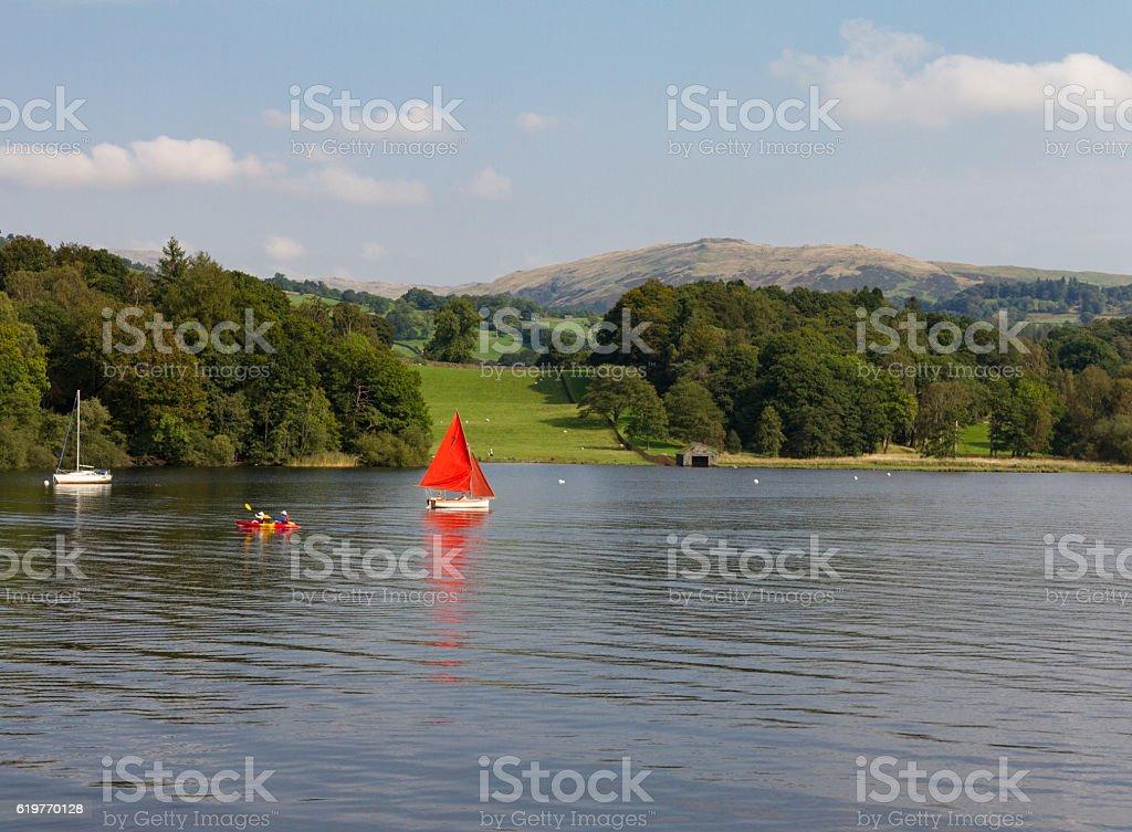 Sailboat, Canoe and Sailboat n Lake Windermere,  Cumbria, UK stock photo