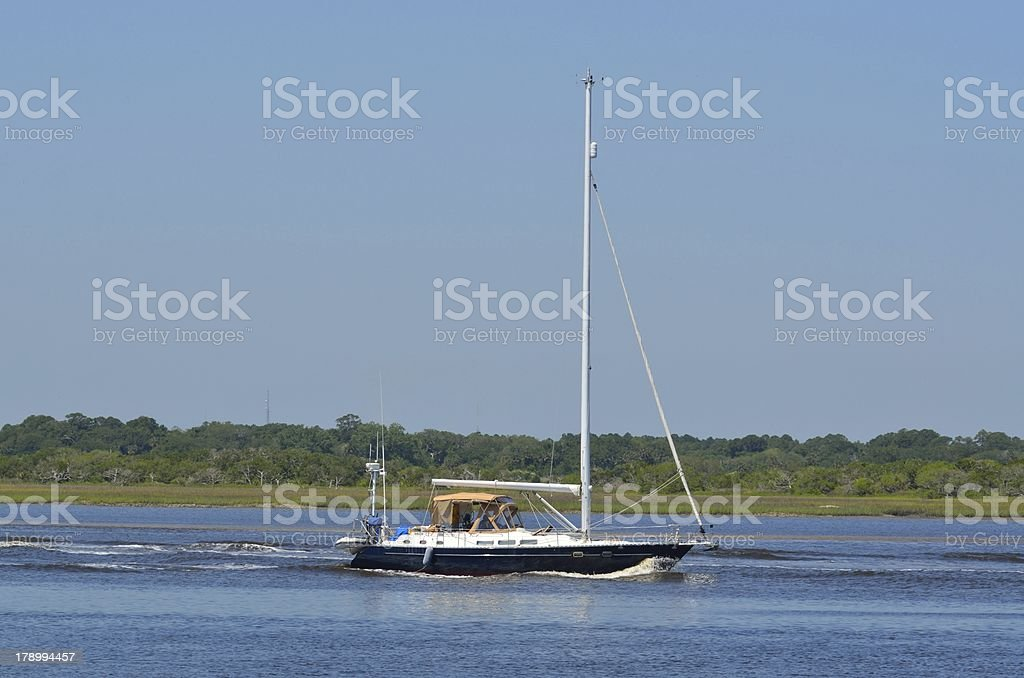 Sailboat cruising on the river royalty-free stock photo