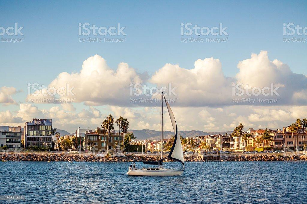 Sailboat Entering Marina Del Rey Channel stock photo