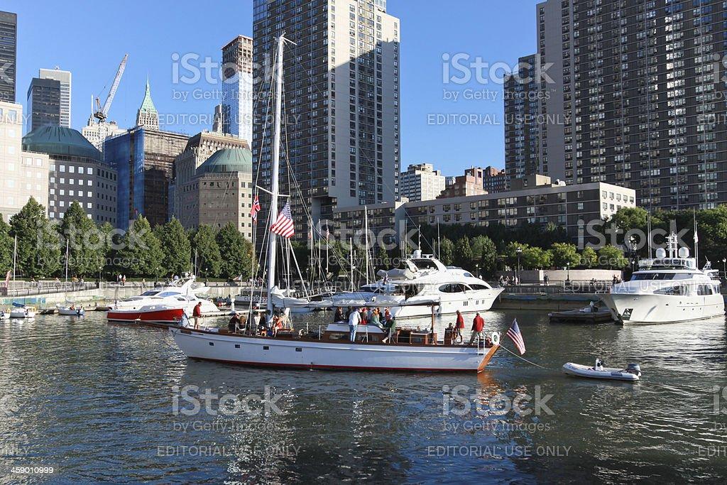 Sailboat entering marina in New York City royalty-free stock photo