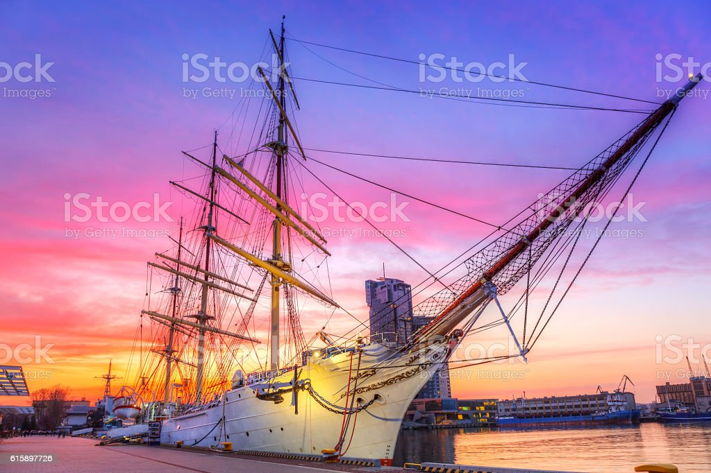 Sailboat in Gdynia harbour at sunset, Poland stock photo