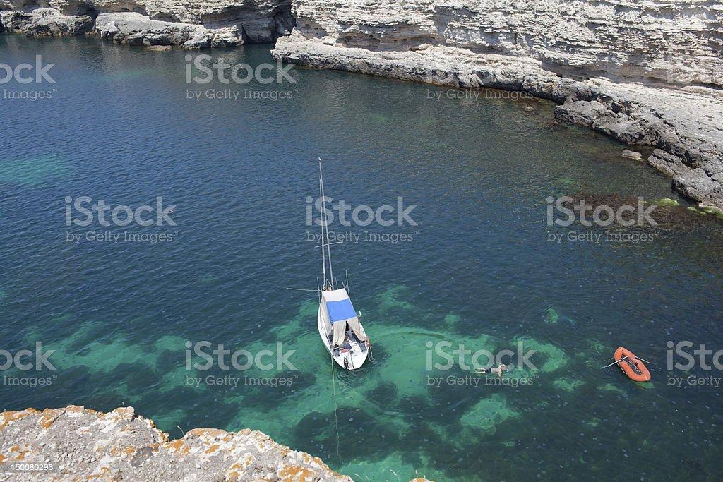 Sailboat in lagoon stock photo
