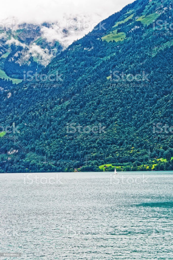 Sailboat in Lake Brienz and Brienzer Rothorn mountain Bern Swiss stock photo