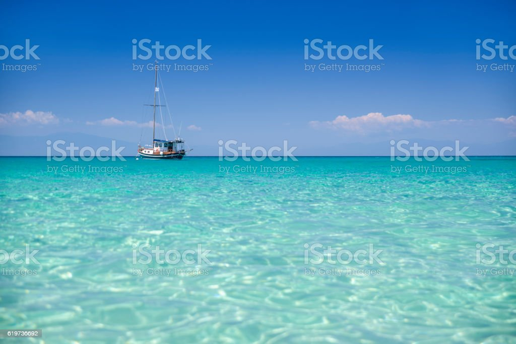 Sailboat in shallow clear water stock photo