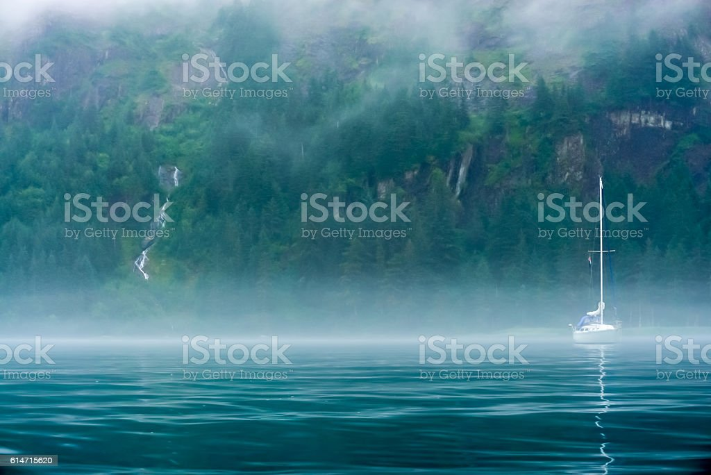 Sailboat in the mist stock photo