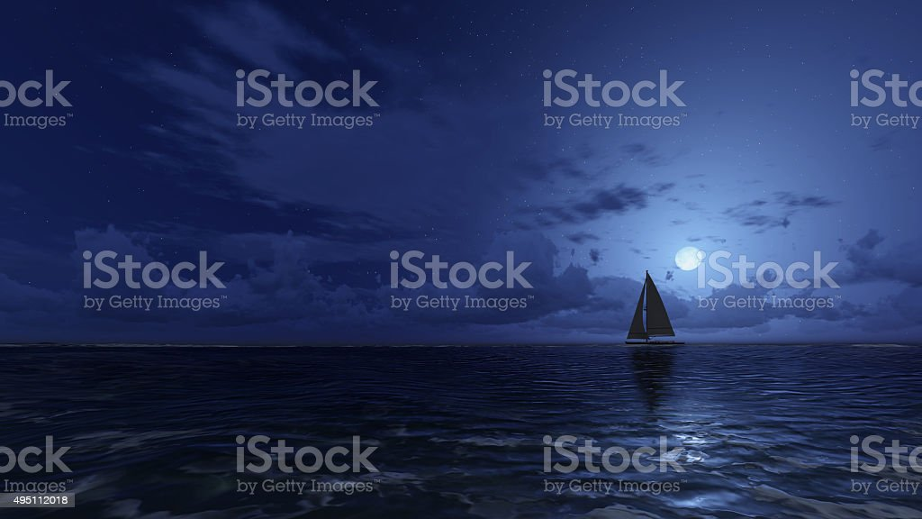 Sailboat in the night ocean stock photo