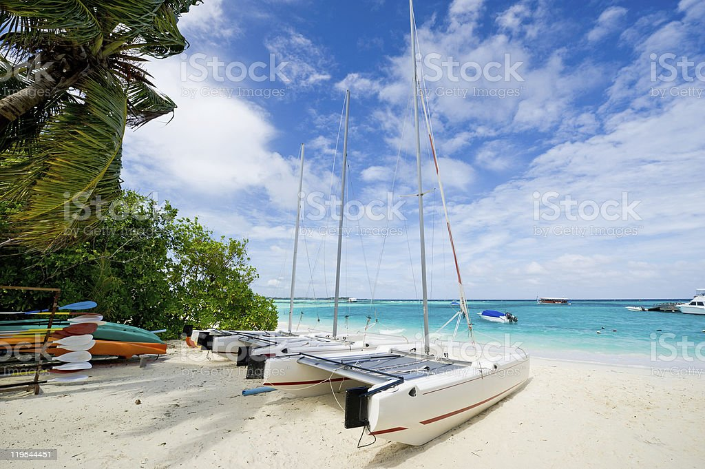 sailboat laying on the maldives island beach stock photo