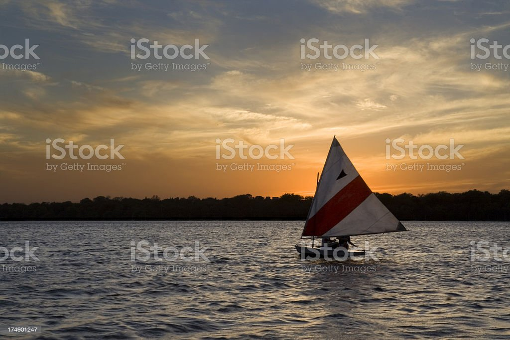 Sailboat, Nautical Vessel Sailing at Sunset on Minneapolis Lake, Minnesota stock photo