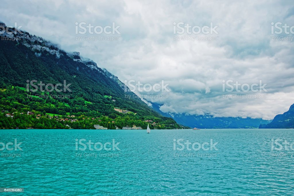 Sailboat on Lake Brienz and Brienzer Rothorn mountain Bern Swiss stock photo