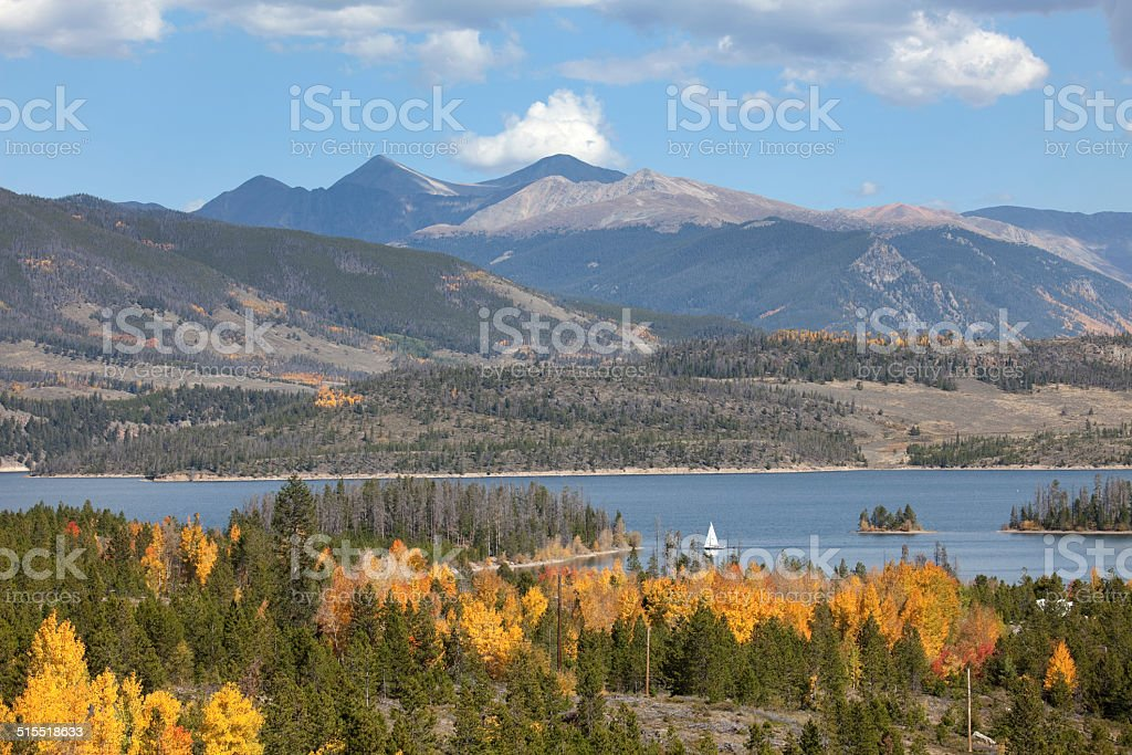 Sailboat on Lake Dillion with autumn Rocky Mountains stock photo