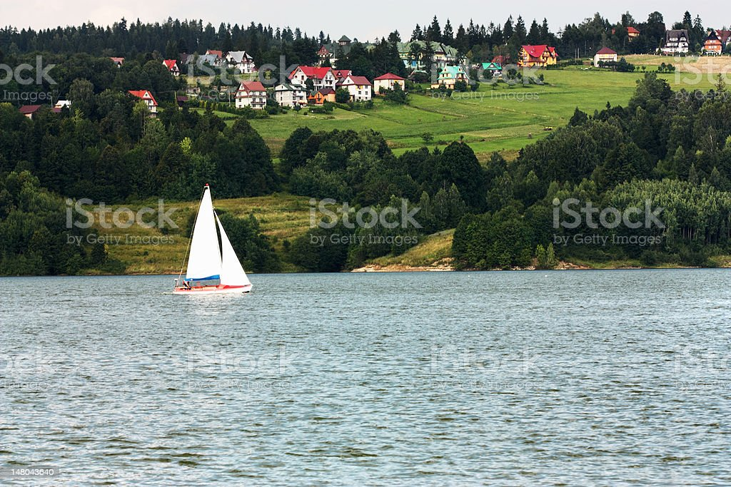Sailboat on lake stock photo