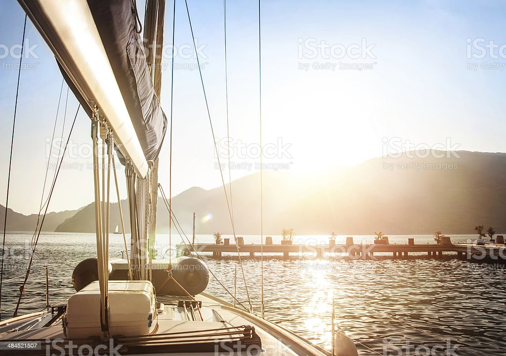 Sailboat on sunset stock photo