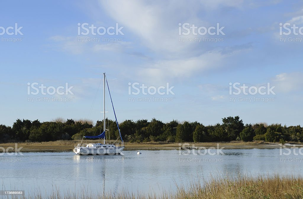 Sailboat on the inlet stock photo