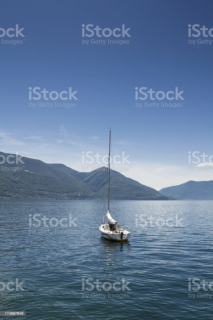 Sailboat on the Lago Maggiore (Switzerland) royalty-free stock photo