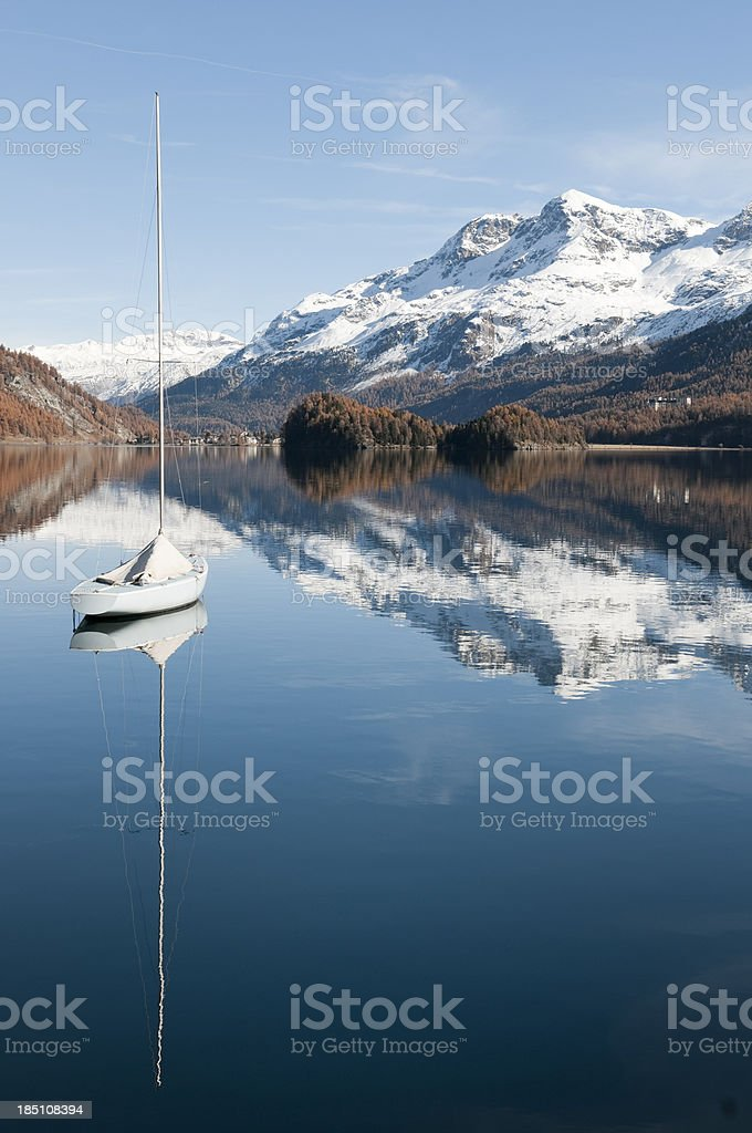 Sailboat on the lake of Silvaplana near St. Moritz stock photo