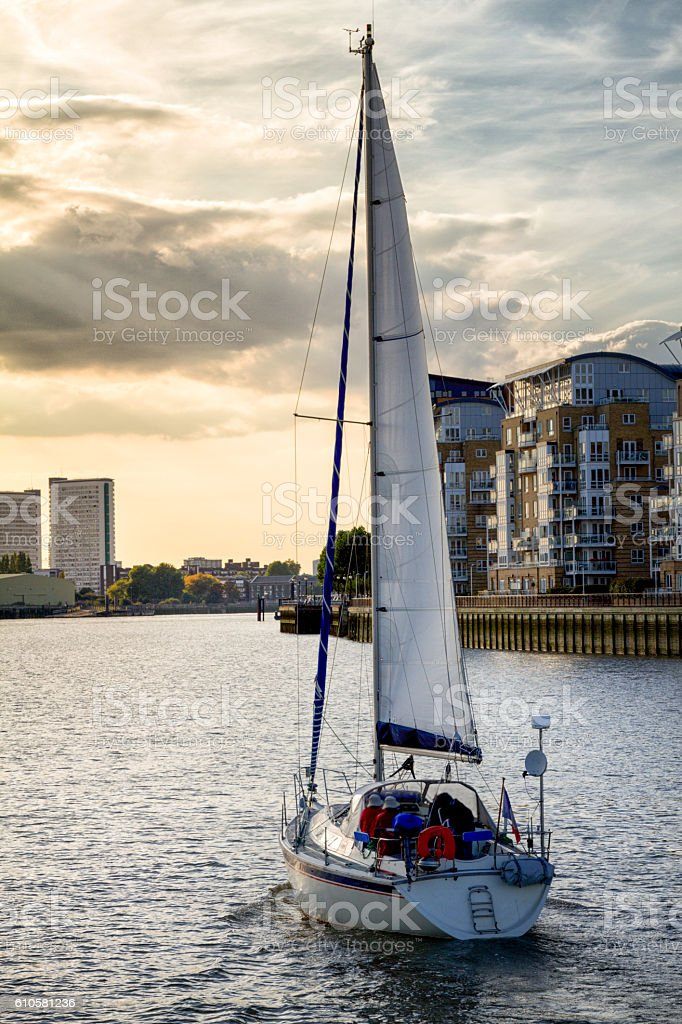 Sailboat on the River Thames in London England at Dusk stock photo