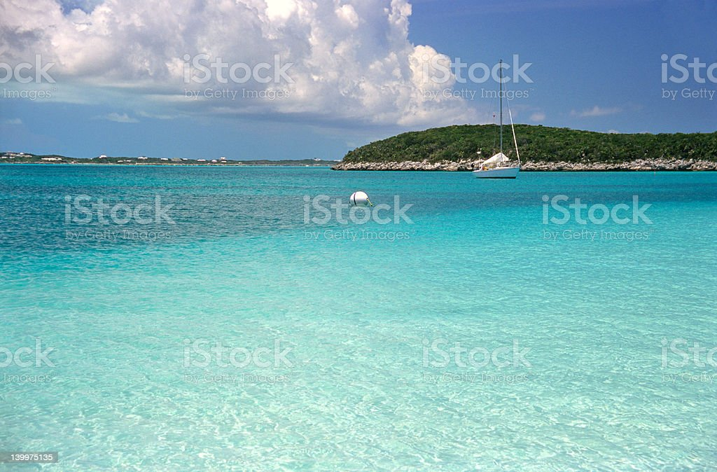 Sailboat on the turquoise caribbean sea royalty-free stock photo