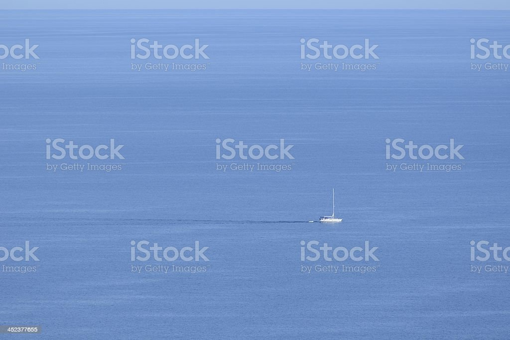 Sailboat on Vast Open Ocean royalty-free stock photo