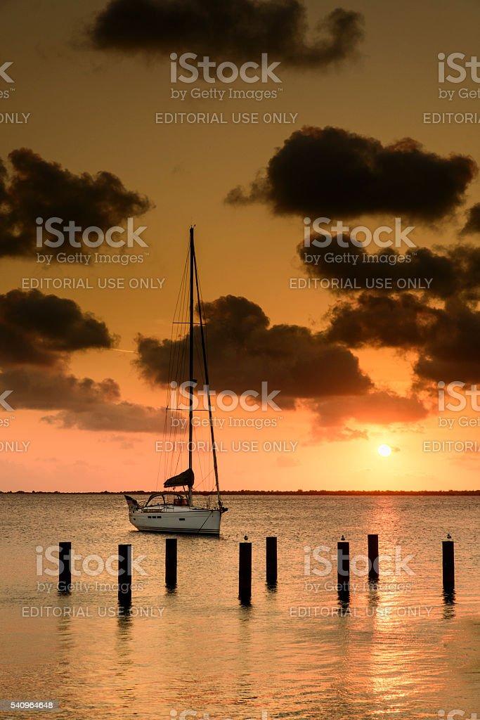 Sailboat orange sunset stock photo
