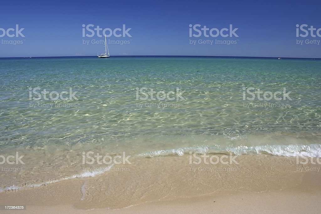 Sailboat resting in a marvellous Sardinian sea royalty-free stock photo