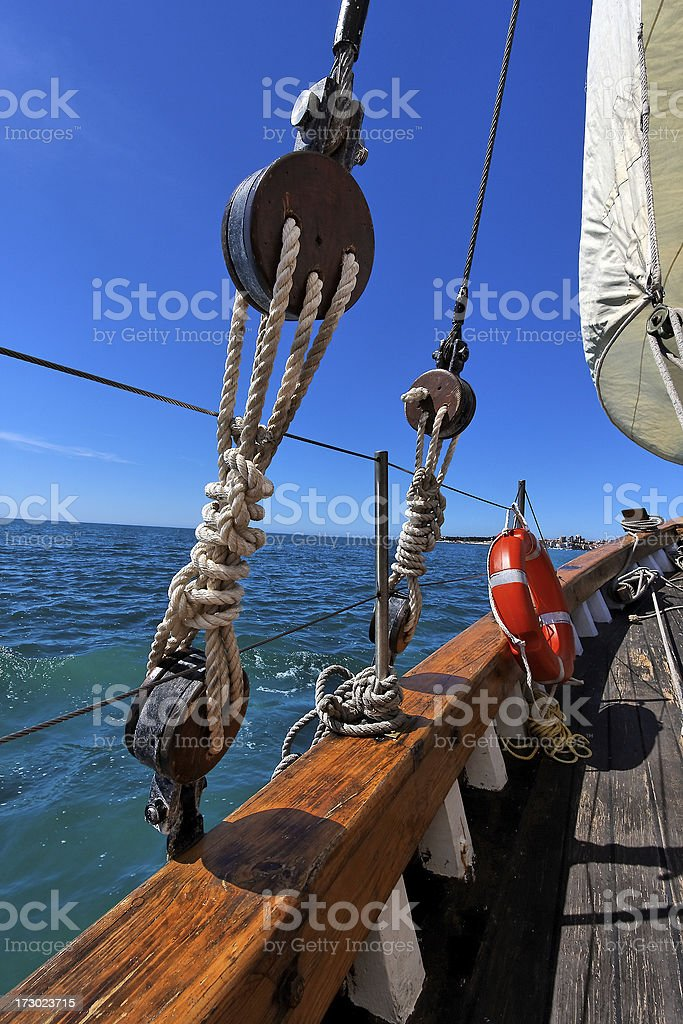 Sailboat rigging against a blue sky and sea royalty-free stock photo