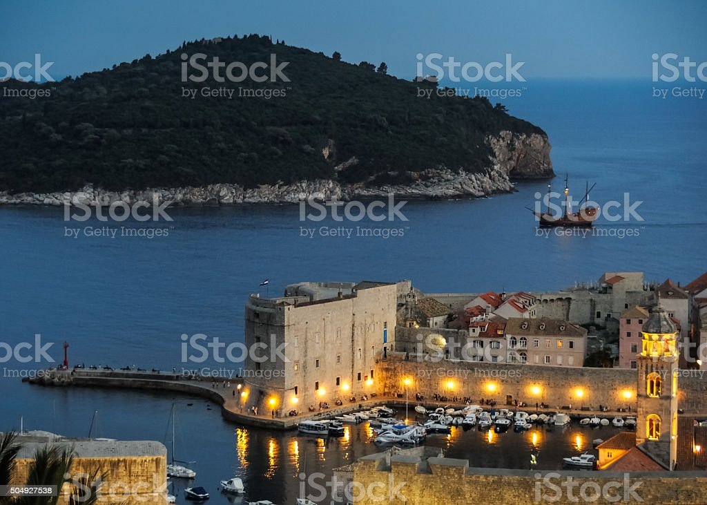 Sailboat runs into the harbor of Dubrovnik stock photo