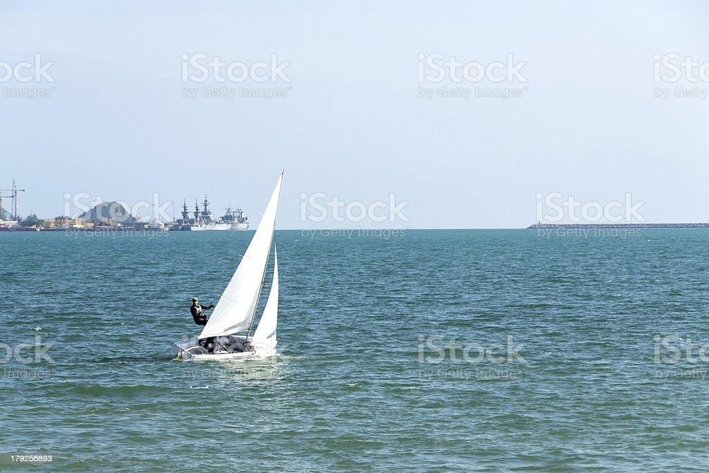 Sailboat sailing through the Sattahip,Thailand royalty-free stock photo