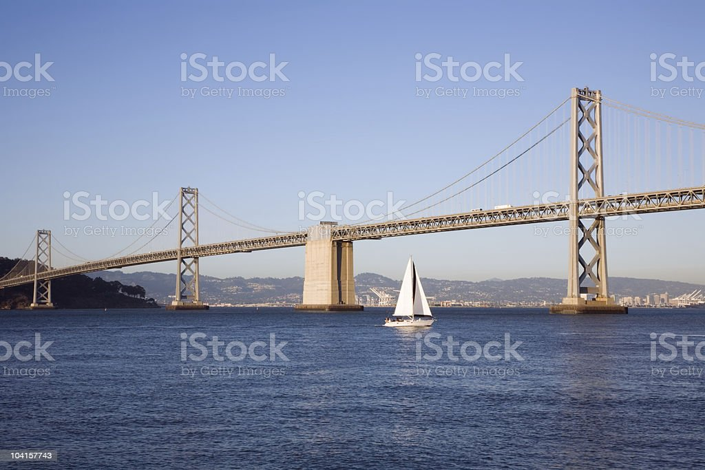 Sailboat Under Bay Bridge royalty-free stock photo