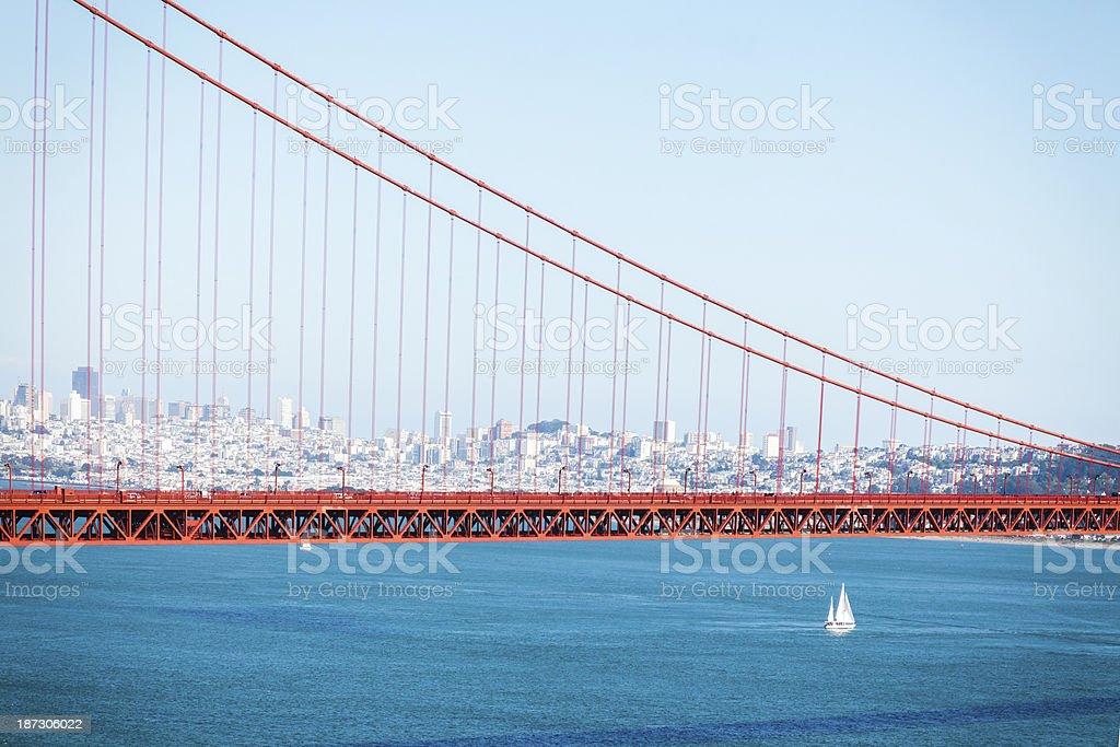 Sailboat under Golden Gate Bridge in Blue day royalty-free stock photo