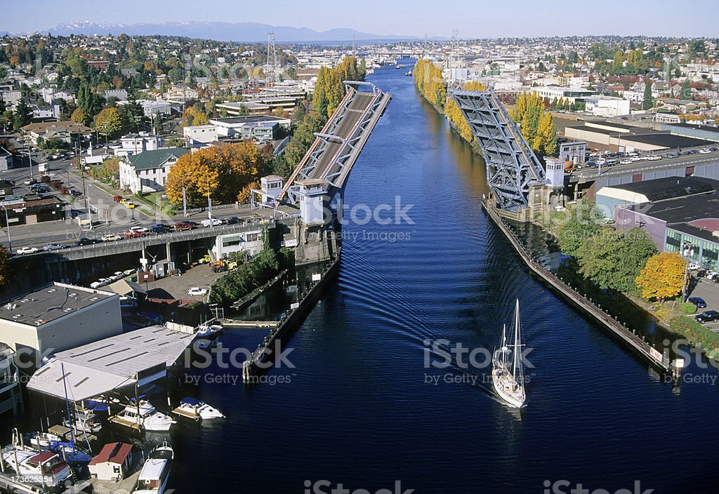 Sailboat under open drawbridge in Ship Canal stock photo