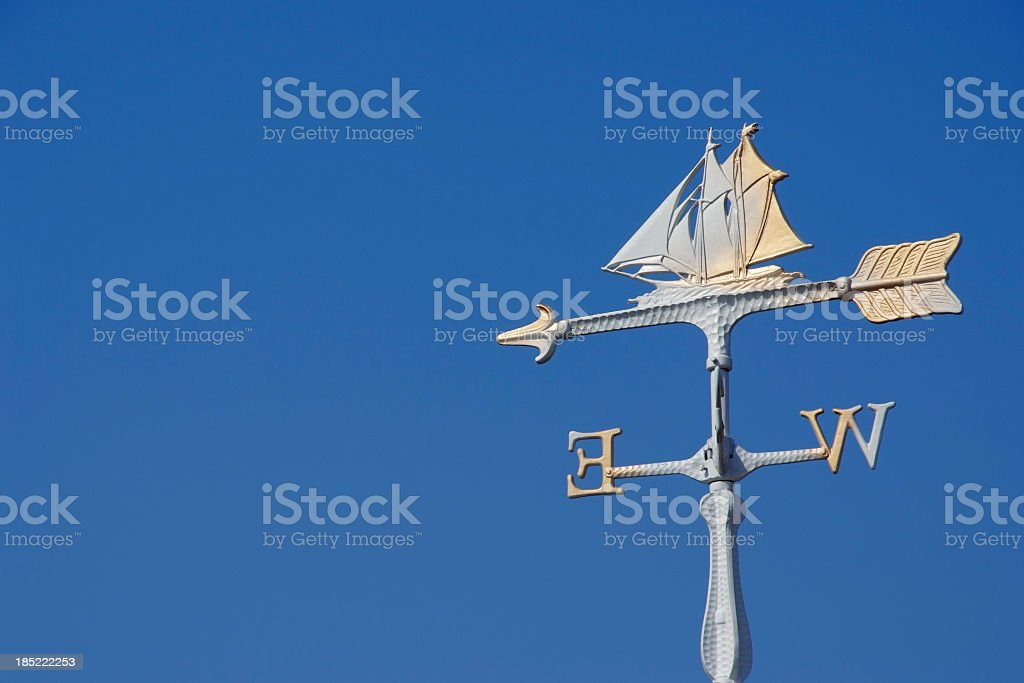 Sailboat wind vane against clear sky with copy space royalty-free stock photo
