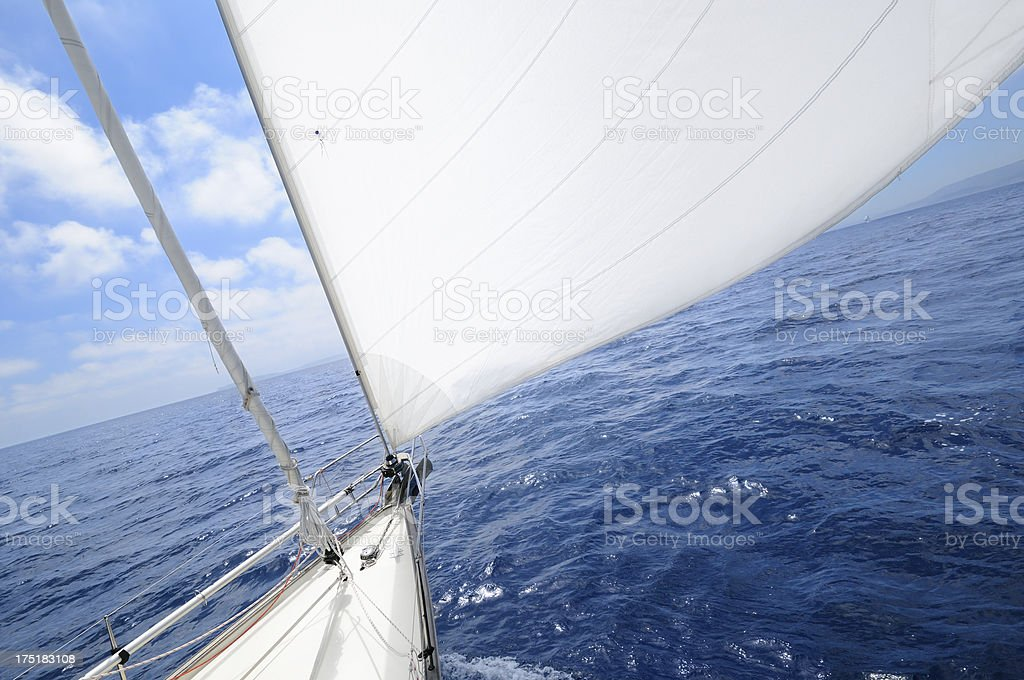Sailboat with white sails on a sunny day at sea royalty-free stock photo