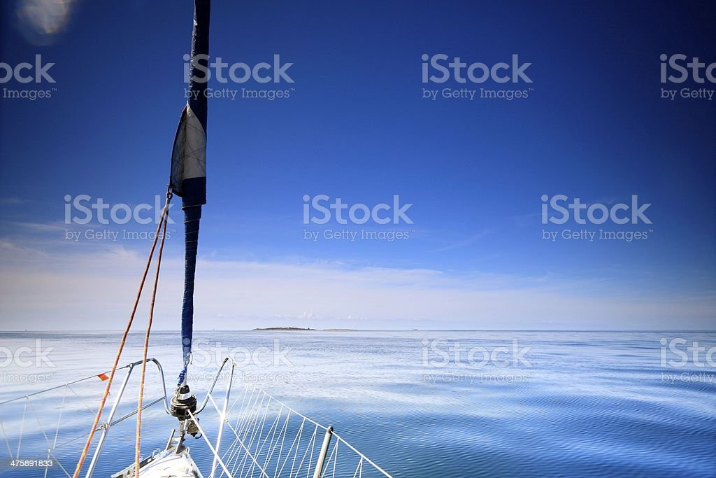 Sailboat yacht sailing in blue sea. Tourism royalty-free stock photo