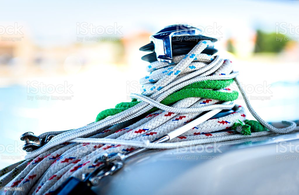 Sailboat yacht winch with multiple tangled ropes. stock photo