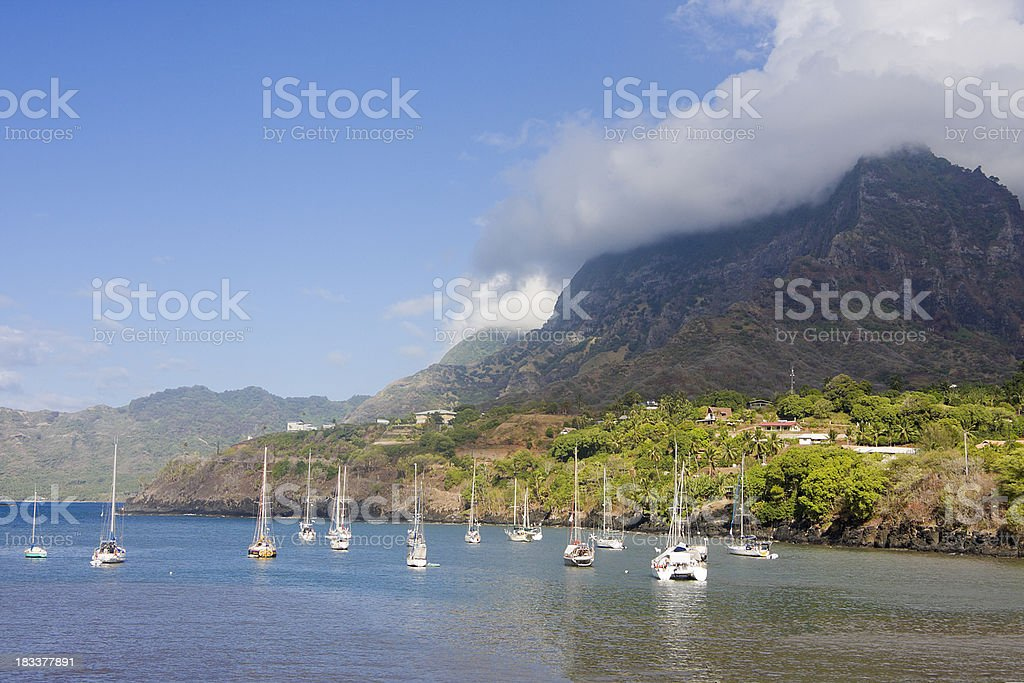 Sailboats Anchored off a South Pacific Island stock photo