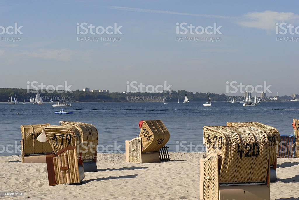 Sailboats and beach chairs royalty-free stock photo
