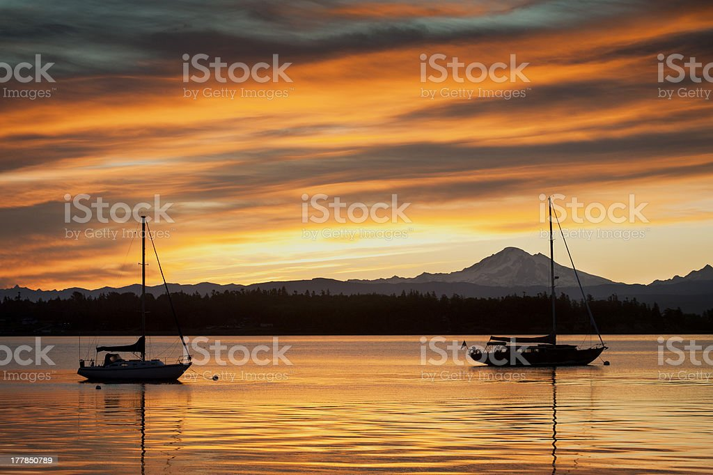 Sailboats and Mt. Baker stock photo