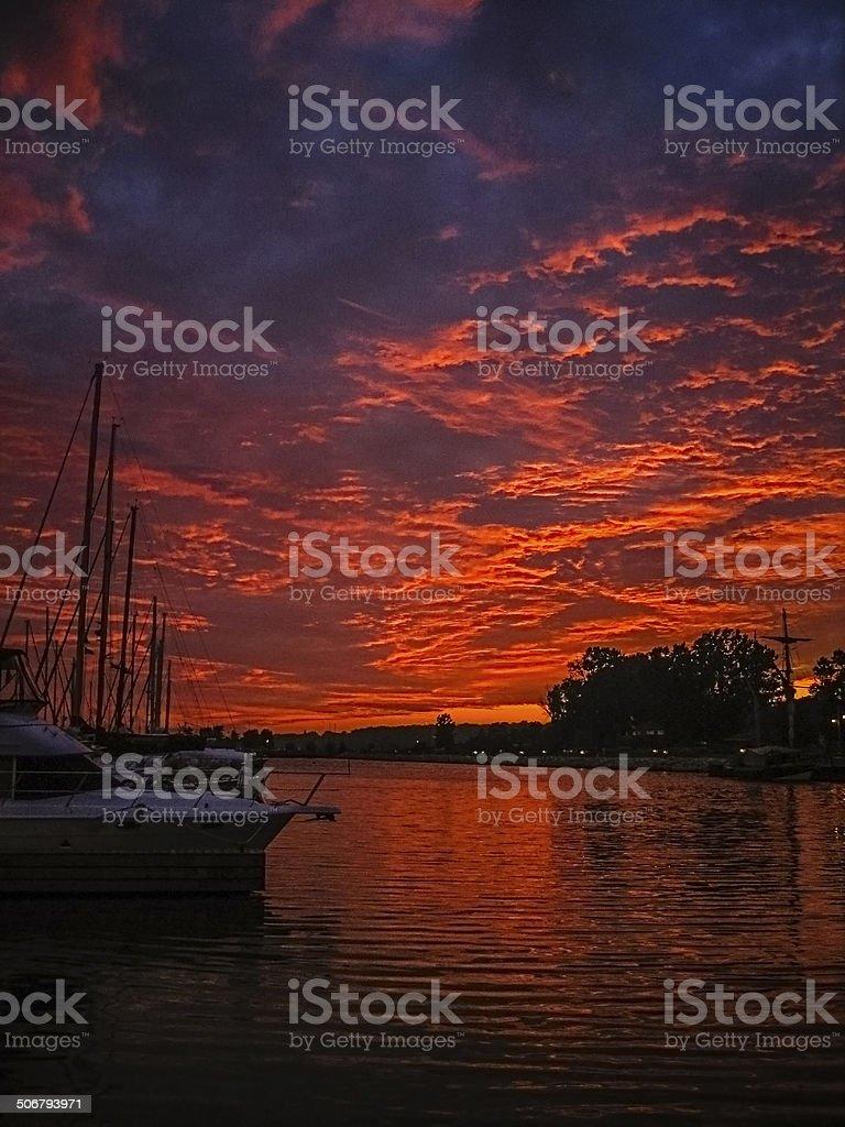 Sailboats at Sunset in a Marina stock photo