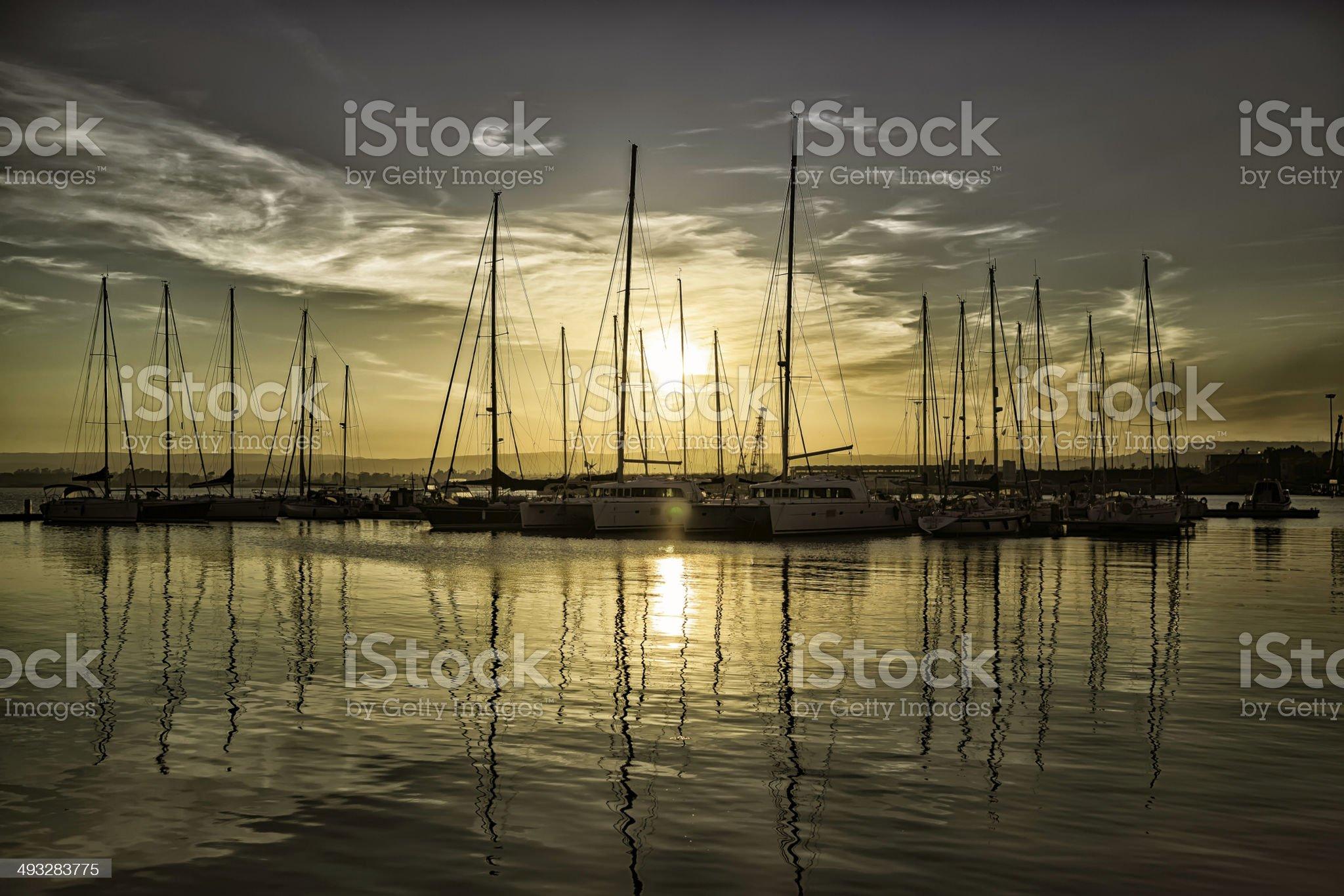 sailboats at sunset royalty-free stock photo