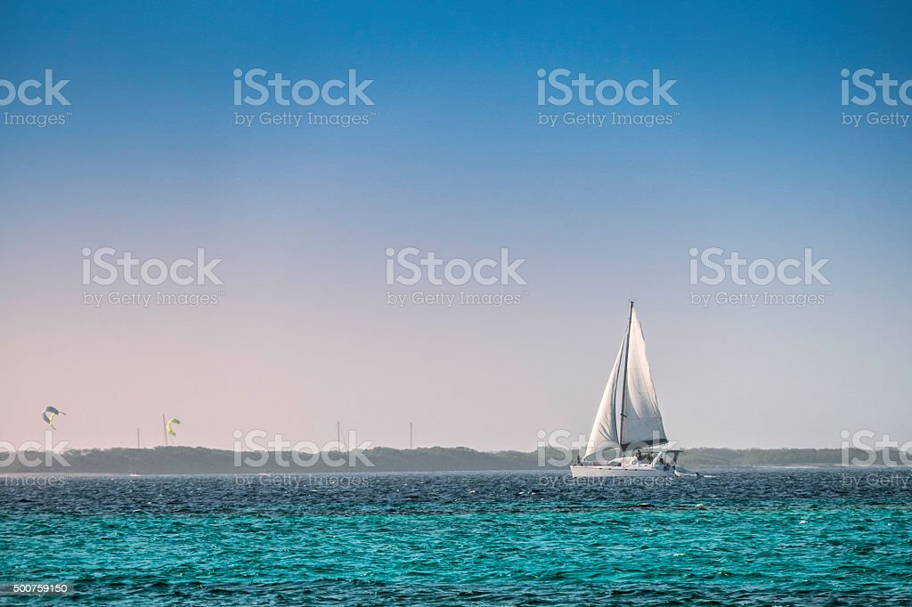 Sailboats in a Caribbean island with turquoise waters stock photo