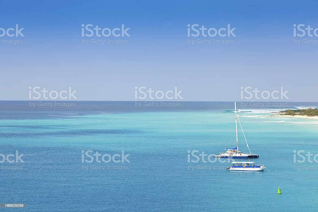 Sailboats in a clear blue ocean at Grand Turk stock photo