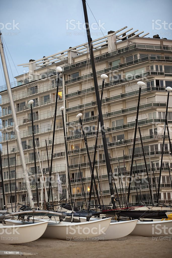 Sailboats in front of buildings stock photo