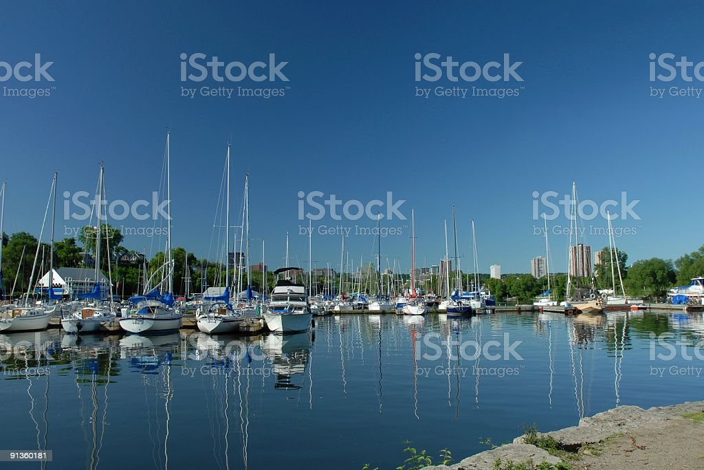 Sailboats in harbor stock photo