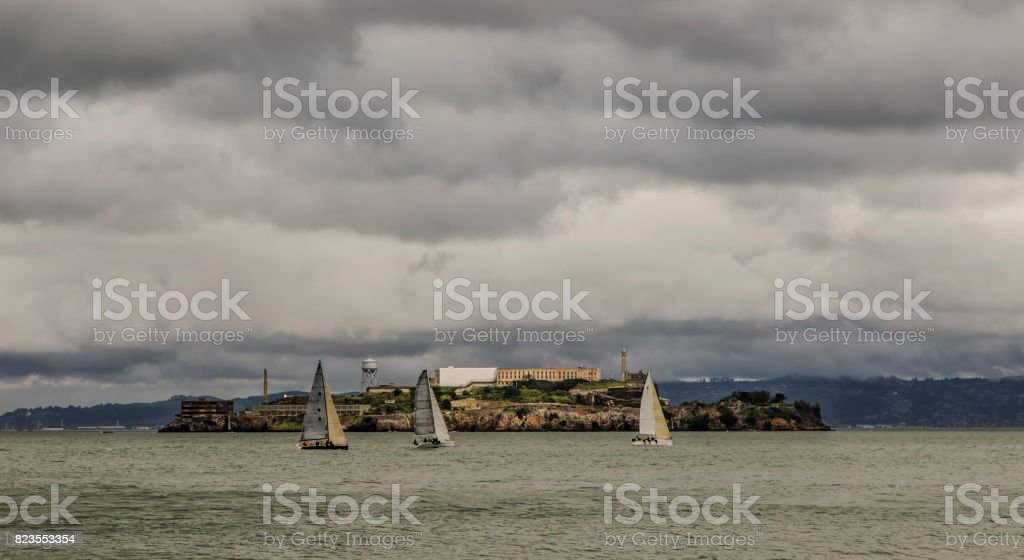 Sailboats in the San Francisco Bay with overcast sky. stock photo