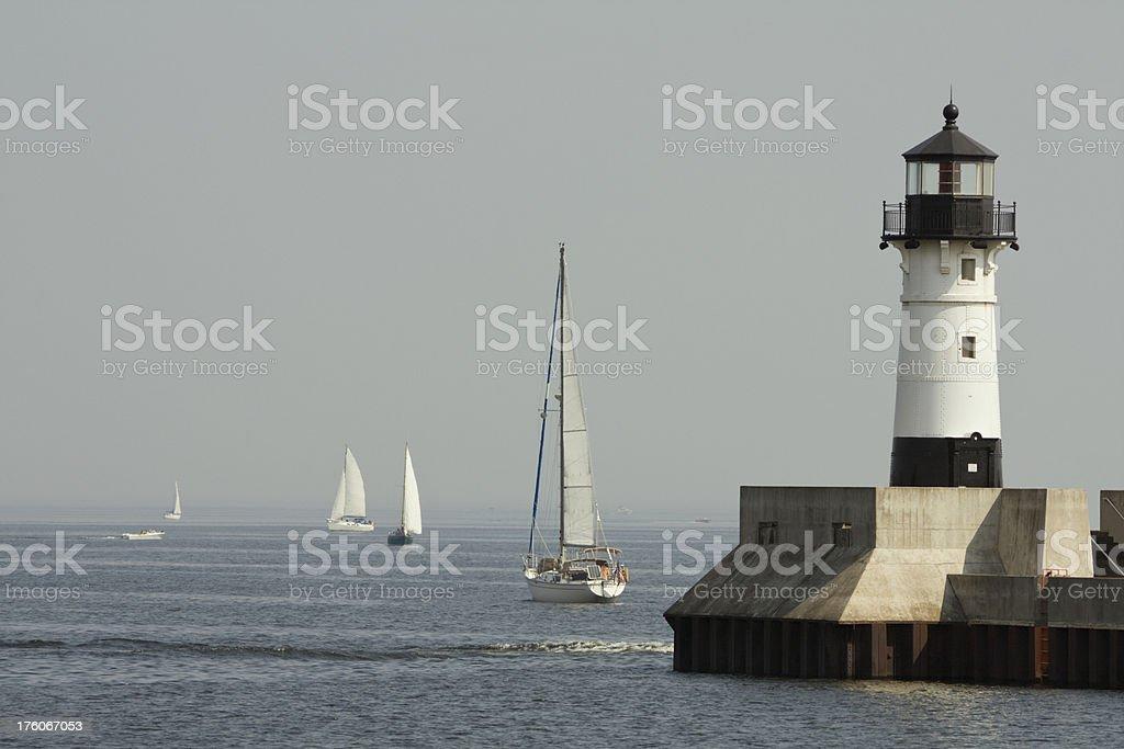 Sailboats & Lighthouse in Duluth Harbor, Minnesota stock photo