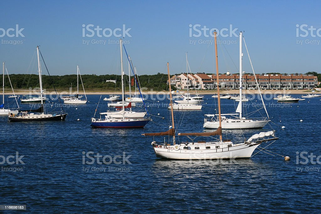 Sailboats moored at Hyannis Harbor, Cape Cod, Massachisetts. Blue sky. royalty-free stock photo