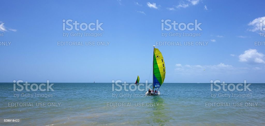 Sailboats off shore from Florida in Gulf of Mexico stock photo
